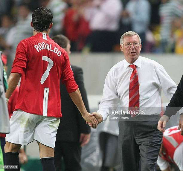 Cristiano Ronaldo of Manchester United shakes hands with Sir Alex Ferguson after the UEFA Champions League match between Sporting Lisbon and...