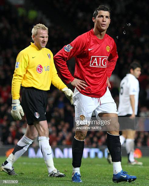 Cristiano Ronaldo of Manchester United spits after a penalty appeal was turned down as Antti Niemi of Fulham walks on during the Premier league...