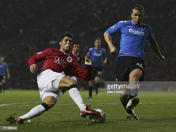 Cristiano Ronaldo of Manchester United takes on Michael Gravgaard of FC Copenhagen during the UEFA Champions League Group F match between Manchester...