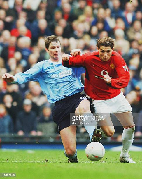 Cristiano Ronaldo of Manchester United takes the ball away from Michael Tarnat of Manchester City during the AXA FA Cup match between Manchester...