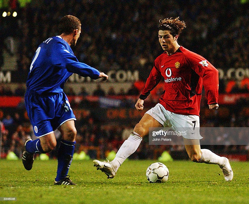 Cristiano Ronaldo of Manchester United takes the ball past Billy McKinlay of Leicester City during the FA Barclaycard Premiership match between Manchester United and Leicester City at Old Trafford on April 13, 2004 in Manchester, England.