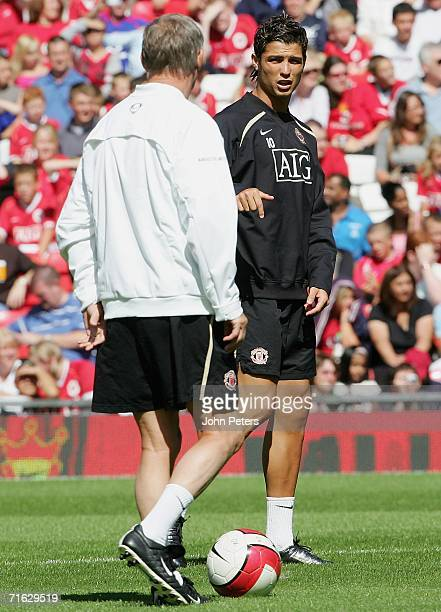 Cristiano Ronaldo of Manchester United talks to Sir Alex Ferguson during a first team training session at Old Trafford on August 11 2006 in...