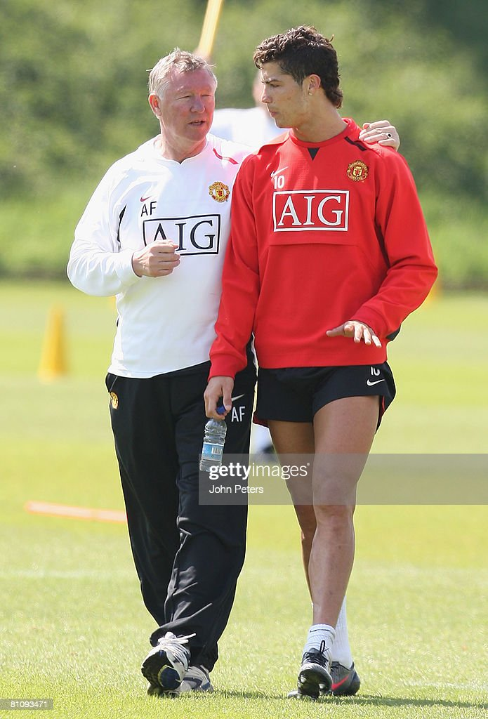 Cristiano Ronaldo of Manchester United talks with SIr Alex Ferguson during a First Team Training Session at Carrington Training Ground on May 15 2008 in Manchester, England.