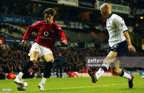 Cristiano Ronaldo of Manchester United tussles with Paul Konchesky of Tottenham during the FA Barclaycard Premiership match between Tottenham Hotspur...