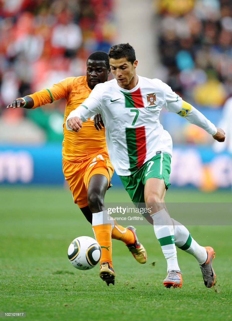 Cristiano Ronaldo of Portugal and Emmanuel Eboue of Ivory Coast battle for the ball during the 2010 FIFA World Cup South Africa Group G match between Ivory Coast and Portugal at Nelson Mandela Bay Stadium on June 15, 2010 in Port Elizabeth, South Africa.