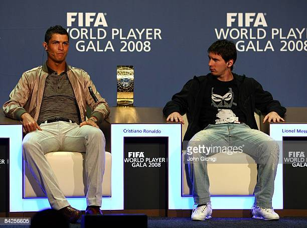 Cristiano Ronaldo of Portugal and Lionel Messi of Argentina listen to questions from the media as nominees of FIFA Player of the Year 2008 at the...
