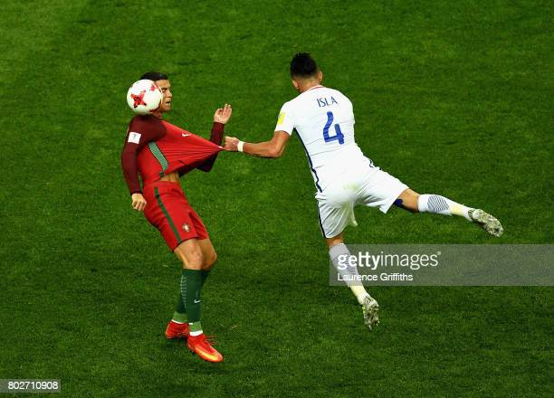 Cristiano Ronaldo of Portugal and Mauricio Isla of Chile battle for possession during the FIFA Confederations Cup Russia 2017 SemiFinal between...