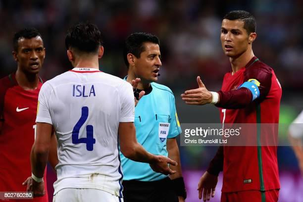 Cristiano Ronaldo of Portugal and Mauricio Isla of Chile talk to referee Alireza Faghani during the FIFA Confederations Cup Russia 2017 SemiFinal...