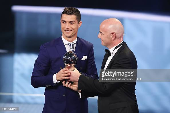 Cristiano Ronaldo of Portugal and Real Madrid accepts The Best FIFA Men's Player Award from FIFA President Gianni Infantino during The Best FIFA...