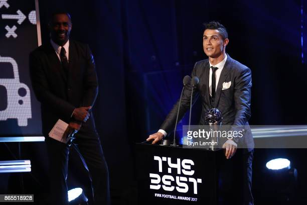 Cristiano Ronaldo of Portugal and Real Madrid CF wins The best Fifa men's player as Idris Elba looks on during The Best FIFA Football Awards Show on...