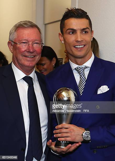 Cristiano Ronaldo of Portugal and Real Madrid poses with his The Best FIFA Men's Player Award next to Sir Alex Ferguson during The Best FIFA Football...