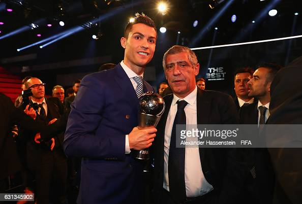 Cristiano Ronaldo of Portugal and Real Madrid poses with his The Best FIFA Men's Player Award next to Fernando Santos of Portugal after The Best FIFA...