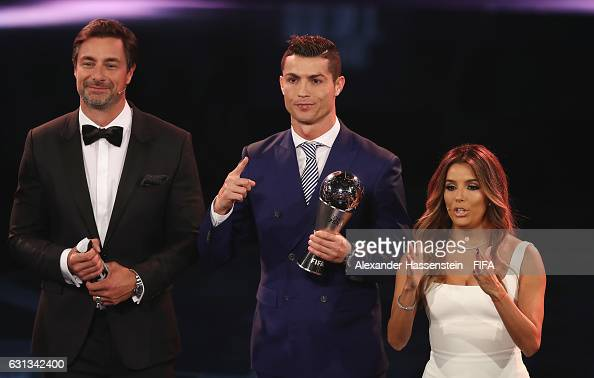 Cristiano Ronaldo of Portugal and Real Madrid poses with The Best FIFA Men's Player Award next to hosts Marcus Schreyl and Eva Longoria during The...