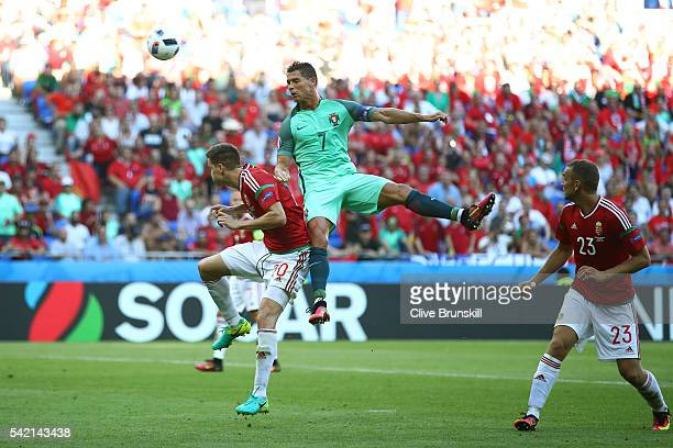 Cristiano Ronaldo of Portugal and Richard Guzmics of Hungary compete for the ball during the UEFA EURO 2016 Group F match between Hungary and...