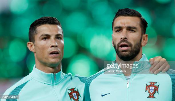 Cristiano Ronaldo of Portugal and Rui Patricio of Portugal listen to the anthems prior to the FIFA 2018 World Cup Qualifier match between Hungary and...