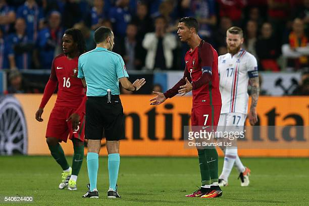 Cristiano Ronaldo of Portugal appeals to referee Cuneyt Cakir during the UEFA Euro 2016 Group F match between Portugal and Iceland at Stade...