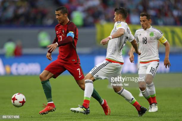 Cristiano Ronaldo of Portugal attempts to take the ball past Hector Moreno of Mexico during the FIFA Confederations Cup Russia 2017 Group A match...