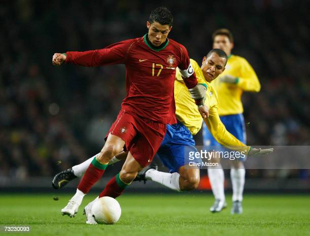 Cristiano Ronaldo of Portugal battles with Gilberto Silva of Brazil during the International friendly match between Brazil and Portugal at the...