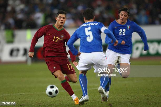 Cristiano Ronaldo of Portugal bears down on Fabio Cannavaro as Massimo Oddo chases during the International Friendly match between Italy and Portugal...