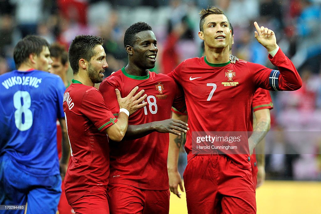 <a gi-track='captionPersonalityLinkClicked' href=/galleries/search?phrase=Cristiano+Ronaldo+-+Soccer+Player&family=editorial&specificpeople=162689 ng-click='$event.stopPropagation()'>Cristiano Ronaldo</a> of Portugal celebrates his goal with Joao Moutinho (L) and Varela (C) of Portugal during the international friendly match between Portugal and Croatia on June 10, 2013 in Geneva, Switzerland.