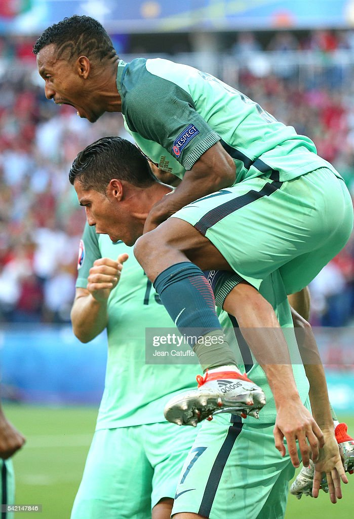Cristiano Ronaldo of Portugal celebrates his last goal with Nani and teammates during the UEFA EURO 2016 Group F match between Hungary and Portugal...