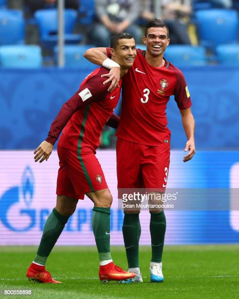 Cristiano Ronaldo of Portugal celebrates scoring his sides first goal with Pepe of Portugal during the FIFA Confederations Cup Russia 2017 Group A...