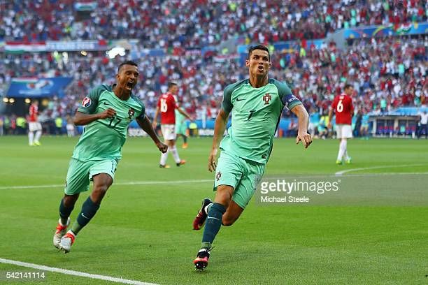 Cristiano Ronaldo of Portugal celebrates scoring his team's second goal with his team mate Nani during the UEFA EURO 2016 Group F match between...