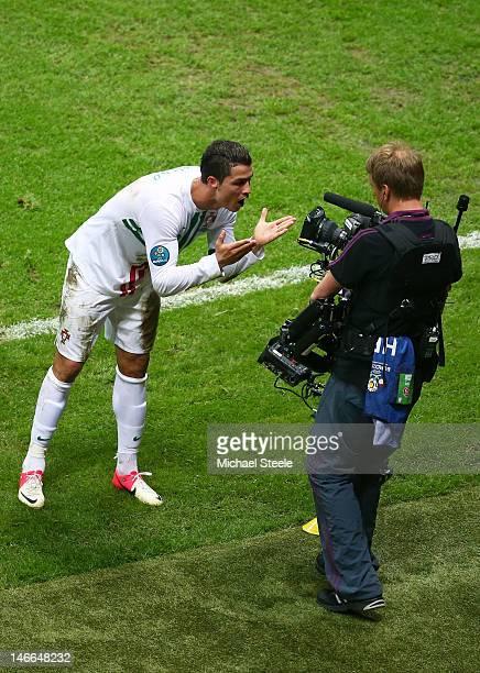 Cristiano Ronaldo of Portugal celebrates scoring the opening goal into a TV camera during the UEFA EURO 2012 quarter final match between Czech...