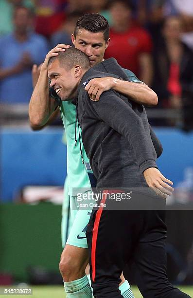 Cristiano Ronaldo of Portugal celebrates the victory with Pepe following the UEFA Euro 2016 semifinal between Wales and Portugal at Parc OL Stade des...