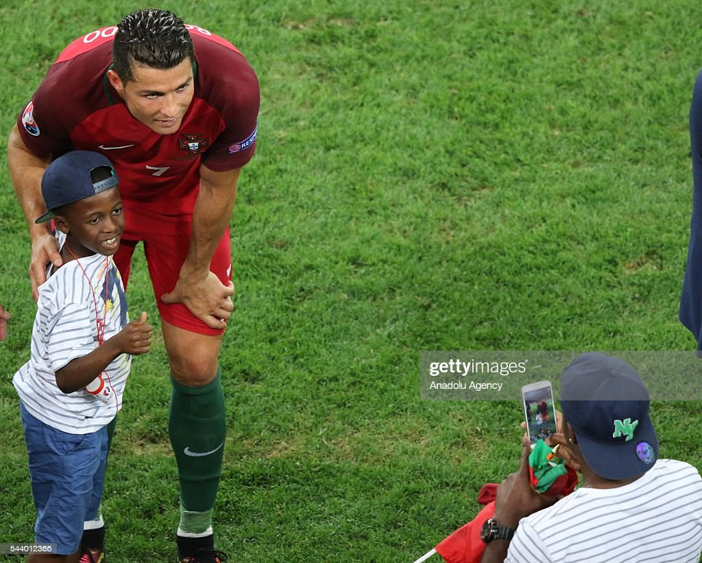 Cristiano Ronaldo of Portugal celebrates with fans after winning the Euro 2016 quarter-final football match between Poland and Portugal at the Stade Velodrome in Marseille on June 30, 2016.