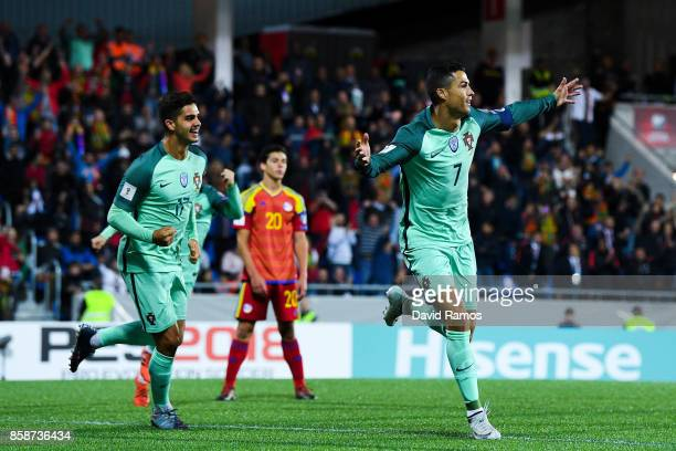 Cristiano Ronaldo of Portugal celebrates with his team mate Andre Silva after scoring the opening goal past the goalkeeper Josep Gomes of...