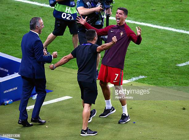 Cristiano Ronaldo of Portugal celebrates with his team staffs after winning the tournament after the UEFA EURO 2016 Final match between Portugal and...