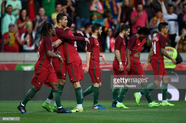 Cristiano Ronaldo of Portugal celebrates with team mates after scoring the first goal against Sweden during the International friendly match between...