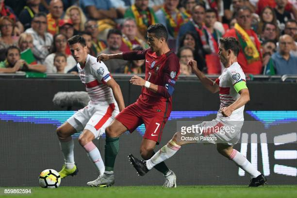 Cristiano Ronaldo of Portugal competes for the ball with Stephan Lichtsteiner of Switzerland during the FIFA 2018 World Cup Qualifier between...