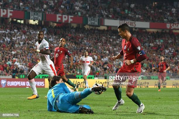 Cristiano Ronaldo of Portugal competes for the ball with Yann Sommer of Switzerland during the FIFA 2018 World Cup Qualifier between Portugal and...