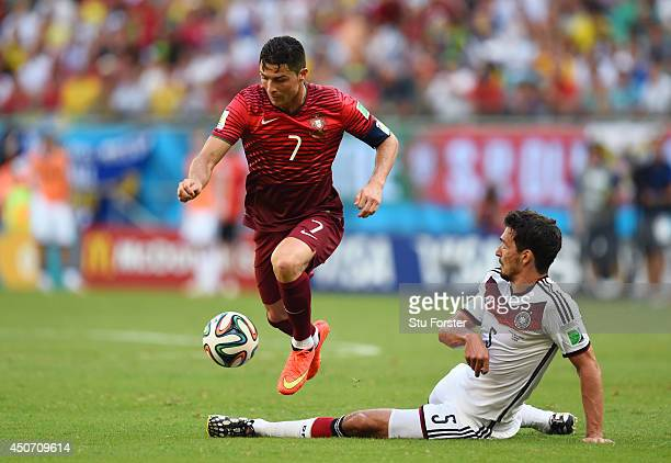 Cristiano Ronaldo of Portugal controls the ball against Mats Hummels of Germany during the 2014 FIFA World Cup Brazil Group G match between Germany...