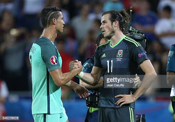 Cristiano Ronaldo of Portugal greets Gareth Bale of Wales following the UEFA Euro 2016 semifinal between Wales and Portugal at Parc OL Stade des...