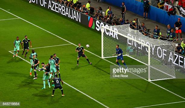 Cristiano Ronaldo of Portugal heads the ball to score the opening goal past Wayne Hennessey of Wales during the UEFA EURO 2016 semi final match...