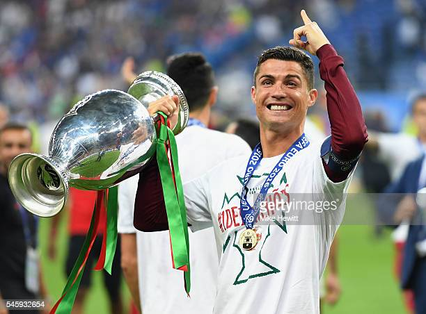 Cristiano Ronaldo of Portugal holds the Henri Delaunay trophy to celebrate after his team's 10 win against France in the UEFA EURO 2016 Final match...