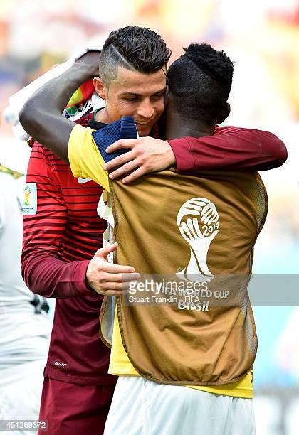 Cristiano Ronaldo of Portugal hugs with Daniel Opare of Ghana after the 2014 FIFA World Cup Brazil Group G match between Portugal and Ghana at...