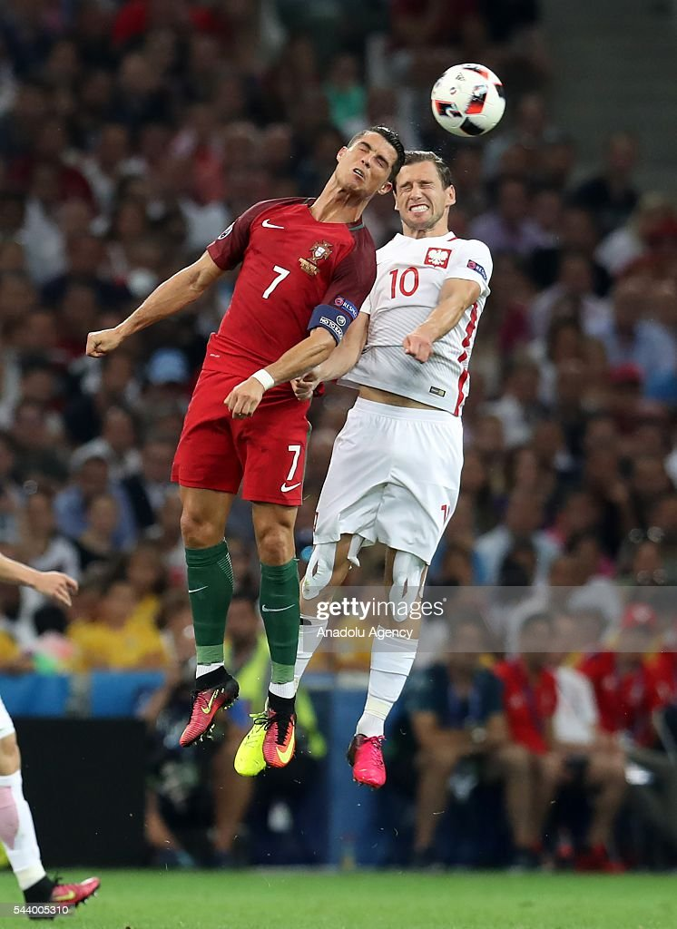 Cristiano Ronaldo (7) of Portugal in action against Grzegorz Krychowiak (10) of Poland during the Euro 2016 quarter-final football match between Poland and Portugal at the Stade Velodrome in Marseille, France on June 30, 2016.