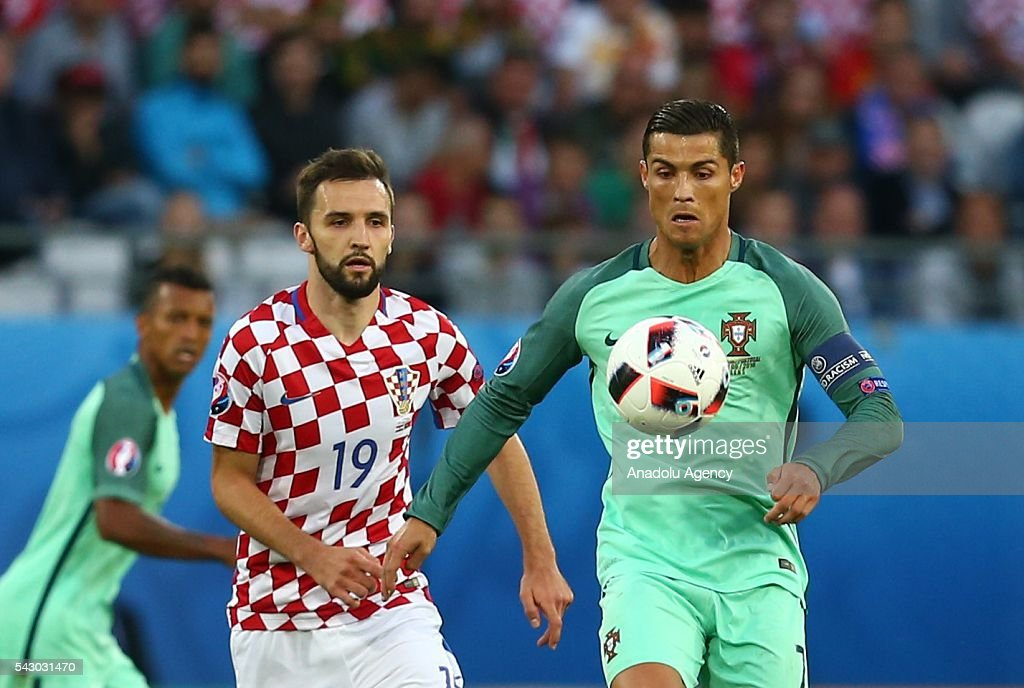 Cristiano Ronaldo (R) of Portugal in action against Milan Badelj (L) of Croatia during the Euro 2016 round of 16 football match between Croatia and Portugal at Stade Bollaert-Delelis in Lens, France on June 25, 2016.