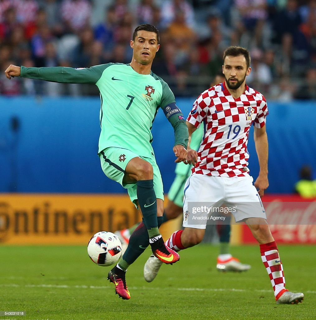 Cristiano Ronaldo (L) of Portugal in action against Milan Badelj (R) of Croatia during the Euro 2016 round of 16 football match between Croatia and Portugal at Stade Bollaert-Delelis in Lens, France on June 25, 2016.