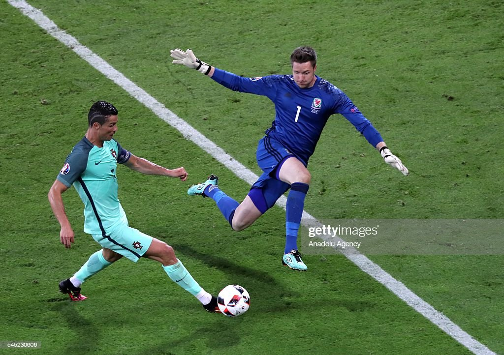 Cristiano Ronaldo (7) of Portugal in action against Wayne Hennessey of Wales during the UEFA Euro 2016 semi final match between Portugal and Wales at Stade de Lyon in Lyon, France on July 6, 2016.