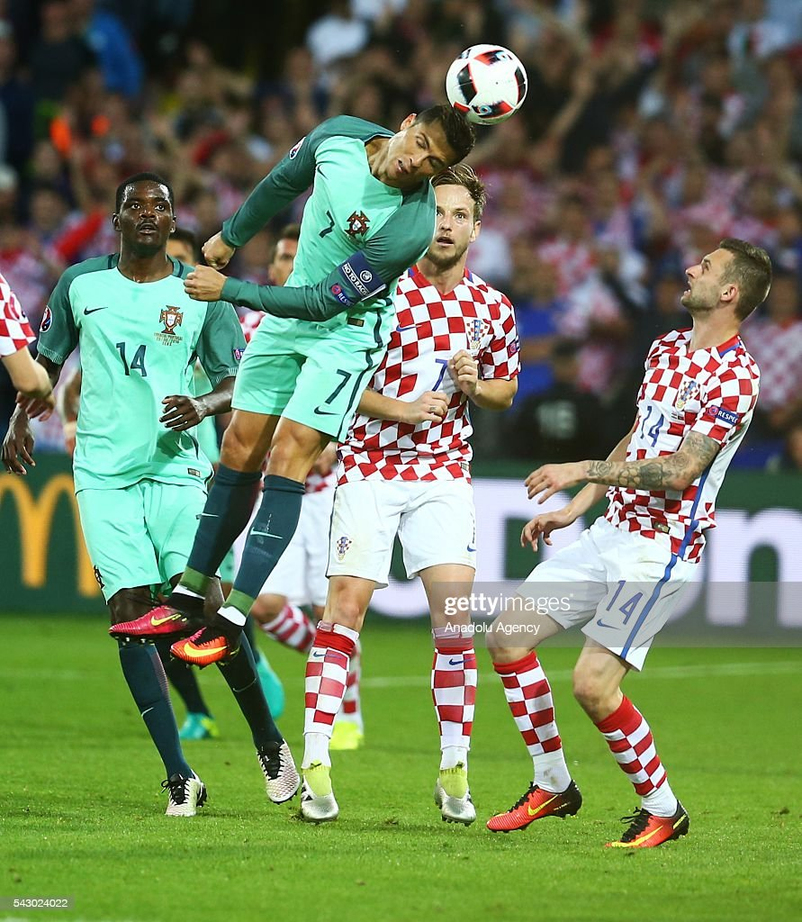 Cristiano Ronaldo (2nd L) of Portugal in action during the Euro 2016 round of 16 football match between Croatia and Portugal at Stade Bollaert-Delelis in Lens, France on June 25, 2016.