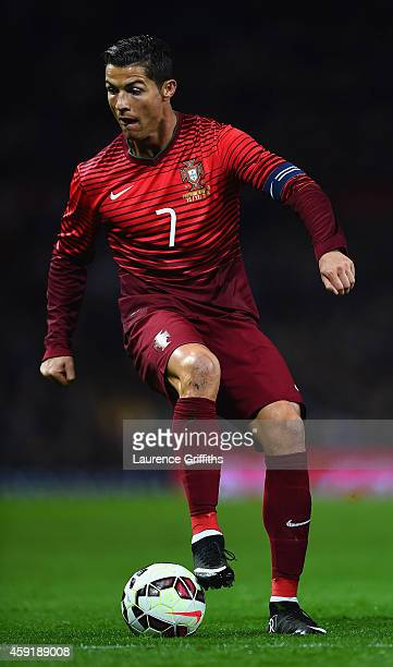 Cristiano Ronaldo of Portugal in action during the International Friendly between Argentina and Portugal at Old Trafford on November 18 2014 in...