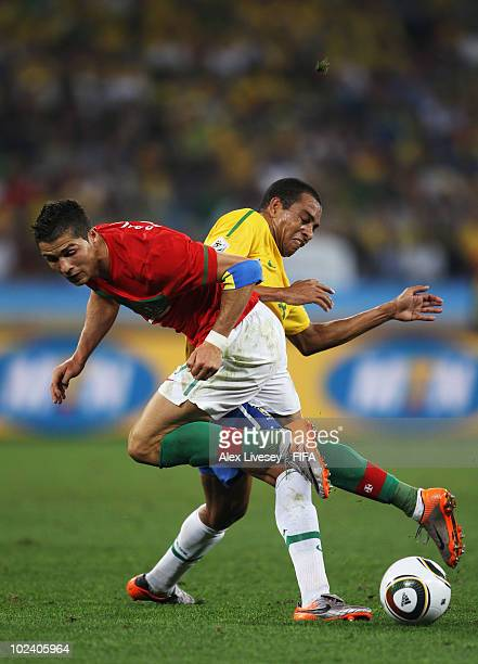 Cristiano Ronaldo of Portugal is challenged by Gilberto Silva of Brazil during the 2010 FIFA World Cup South Africa Group G match between Portugal...