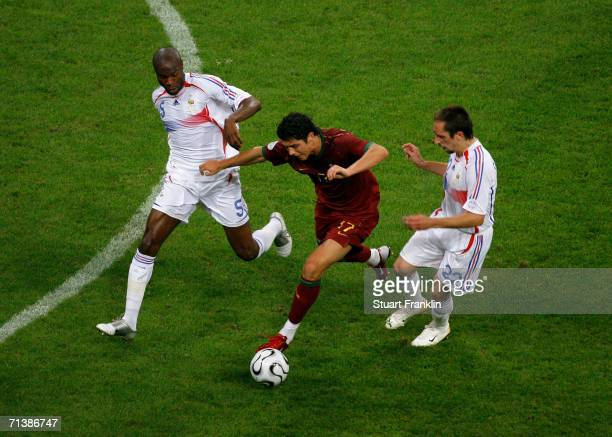 Cristiano Ronaldo of Portugal is challenged by William Gallas and Franck Ribery of France during the FIFA World Cup Germany 2006 Semifinal match...