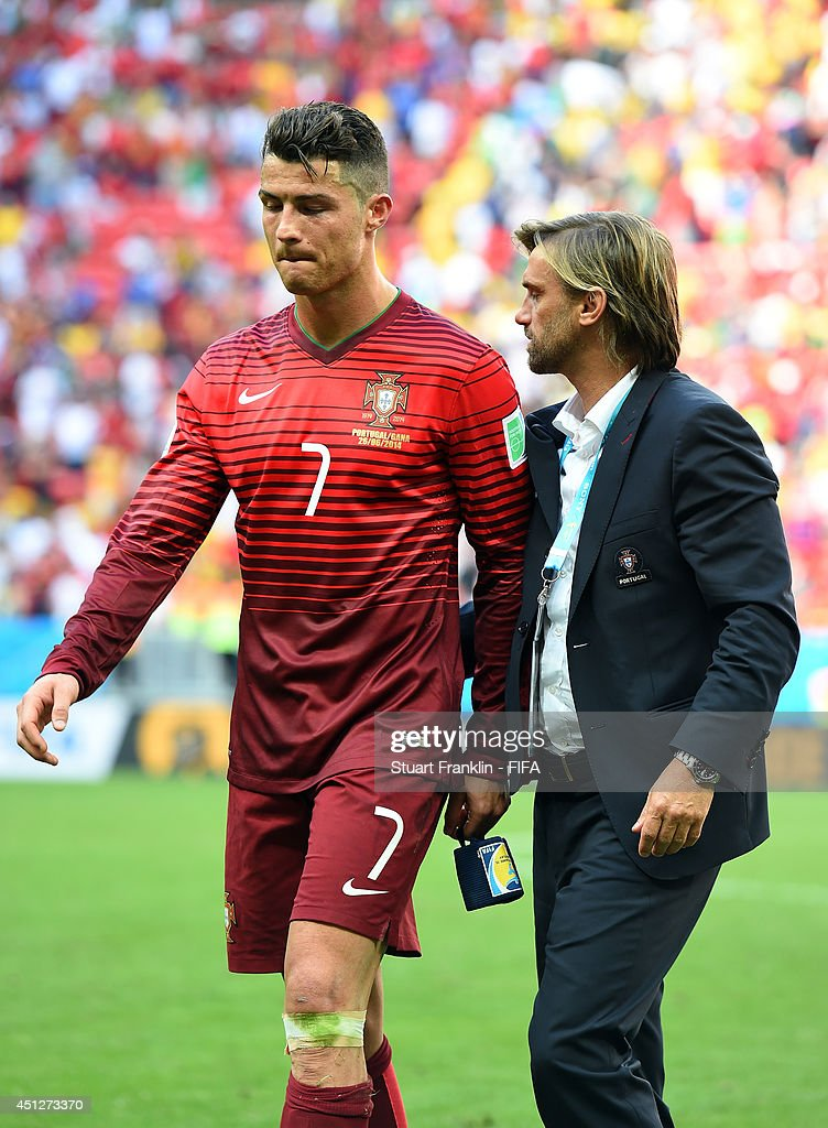 Cristiano Ronaldo of Portugal is consoled after the 2014 FIFA World Cup Brazil Group G match between Portugal and Ghana at Estadio Nacional on June 26, 2014 in Brasilia, Brazil.