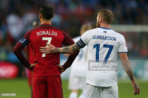 Cristiano Ronaldo of Portugal is consoled by Aron Gunnarsson of Iceland during the UEFA Euro 2016 Group F match between Portugal and Iceland at Stade...